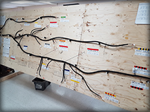 A wire harness assembly laid out during assembly